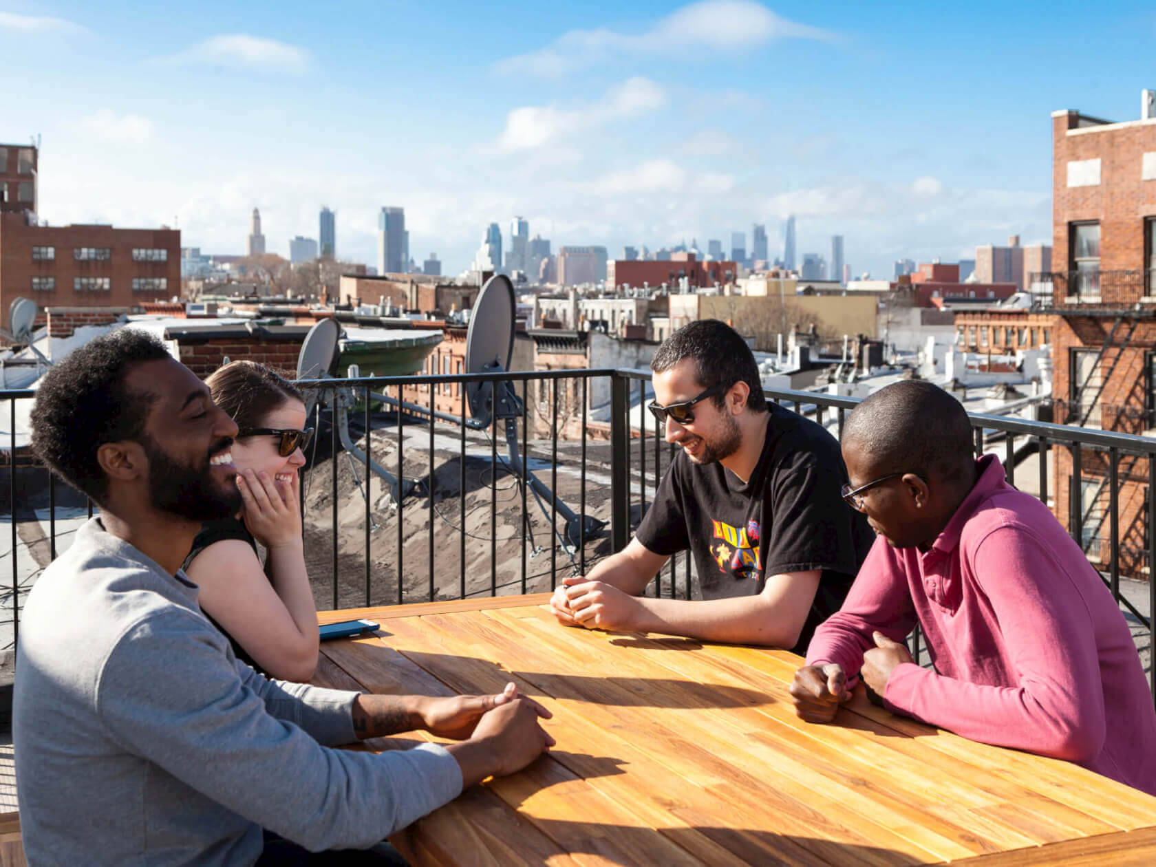 Members at Common Herkimer enjoy an afternoon on their private rooftop.