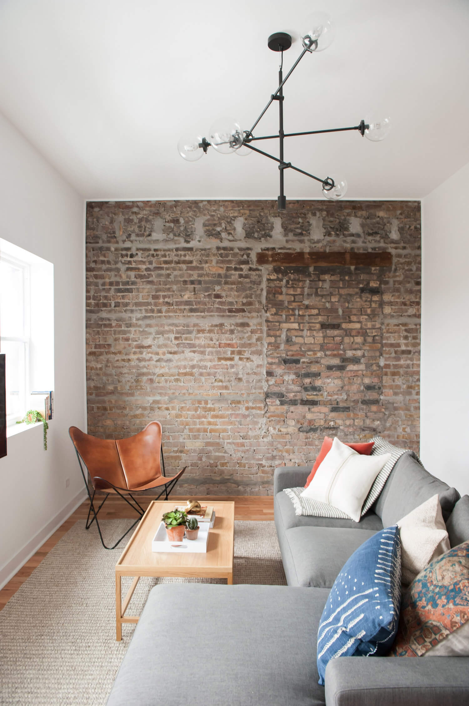 Mix brick, leather, and upholstery for textural balance.